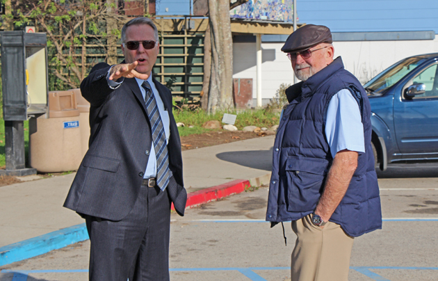 Chief Deputy District Attorney Hilary Dozer, left, and defense attorney Steve Balash accompany the jury in the Adrian Robles murder trial on Wednesday's site visit to Arroyo Burro Beach, the scene of 2010's fatal stabbing of Robert Simpson. (John Palminteri / KEYT News photo)