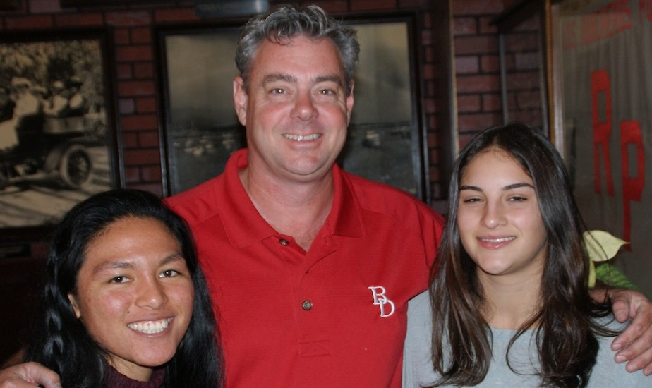 Bishop Diego girls basketball coach Jeff Burich is joined by senior Ann Bentajado, left, and junior Nataltie Whiting.