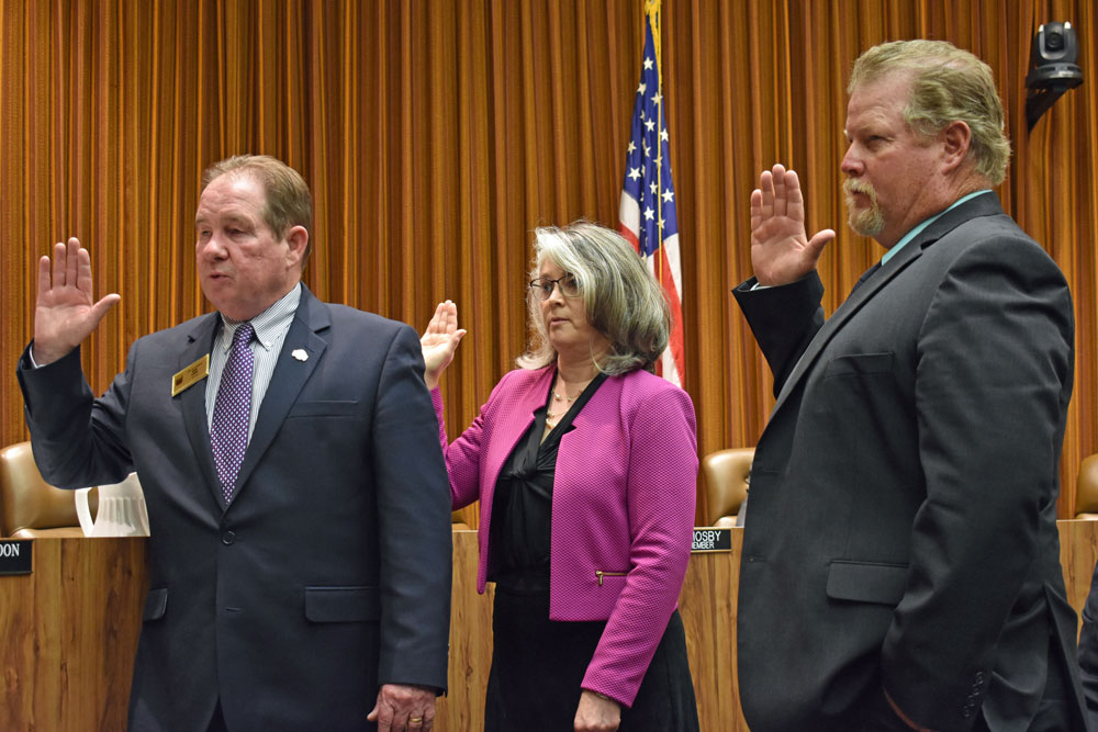 Mayor Bob Lingl, Councilwoman Jenelle Osborne and Councilman Jim Mosby take the oath of office Tuesday night in Lompoc