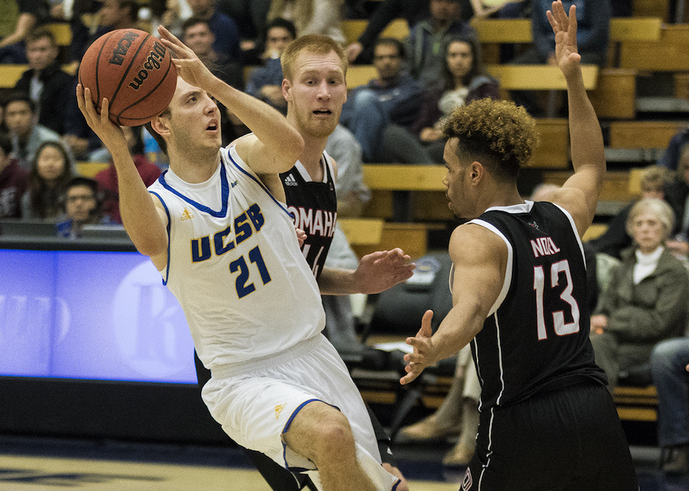 Max Heidegger of UCSB drives around Daniel Norl of Nebraska-Omaha for two of his game-high 25 points.