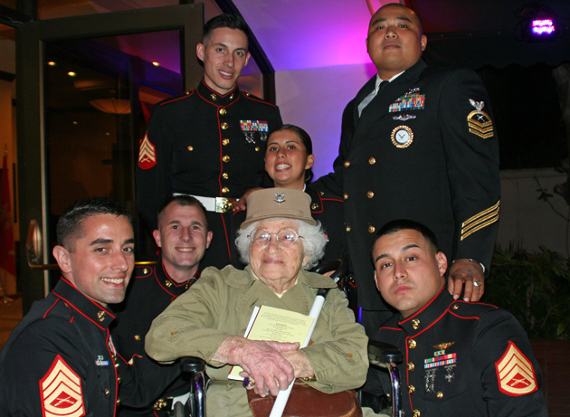 Bea Cohen, a 102-year-old World War II veteran, is surrounded by fellow Marines, top row left to right, Sgt. Mason Turner and Pvt. Teena Sifuentez; bottom row left to right, Marine Sgt. Michael Perri, Sgt. Steven Neese and Sgt. Francis Ramos at the Pierre Claeyssens Veterans Museum & Library's 17th Annual Military Ball held at Fess Parker's DoubleTree Resort. (Melissa Walker / Noozhawk photo)