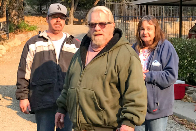 Matilija Canyon residents Dick Carroll, center, with his son, Billie, and neighbor, Katie Wellman. They are among a few residents of the rural enclave north of Ojai who decided not to evacuate for the Thomas Fire.