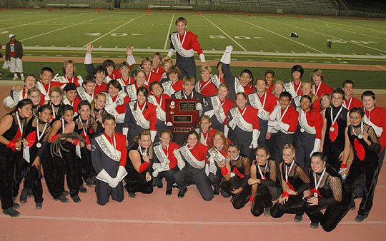 Members of the San Marcos Royals High School Marching Band flash their winning smiles after earning first place in the Southern California School Band & Orchestra Association championship on Saturday at Pasadena City College.