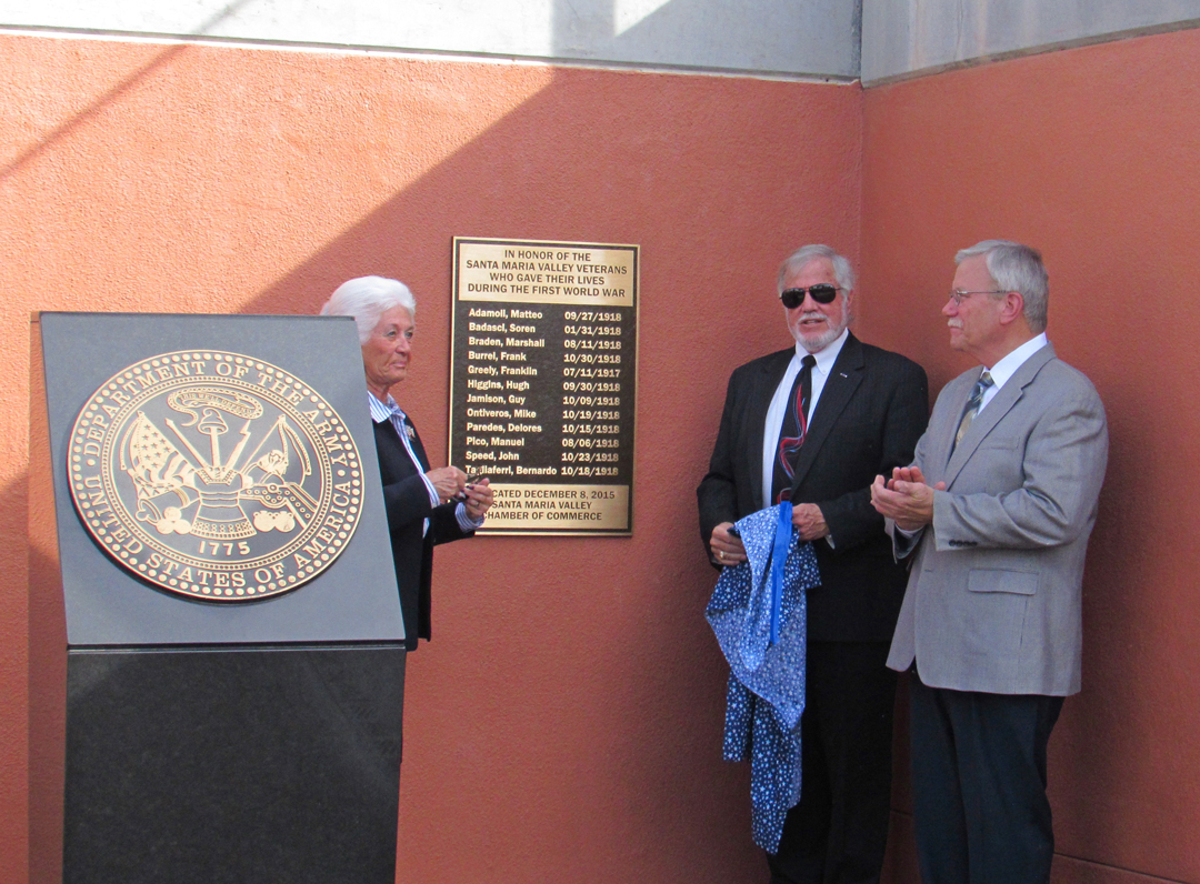 "Mayor Alice Patino, Bob Hatch, chairman of the Santa Maria Military Affairs Committee and a highly decorated Vietnam veteran, and Edward ""Jim"" Zemaitas talk in front of the newly unveiled plaque."