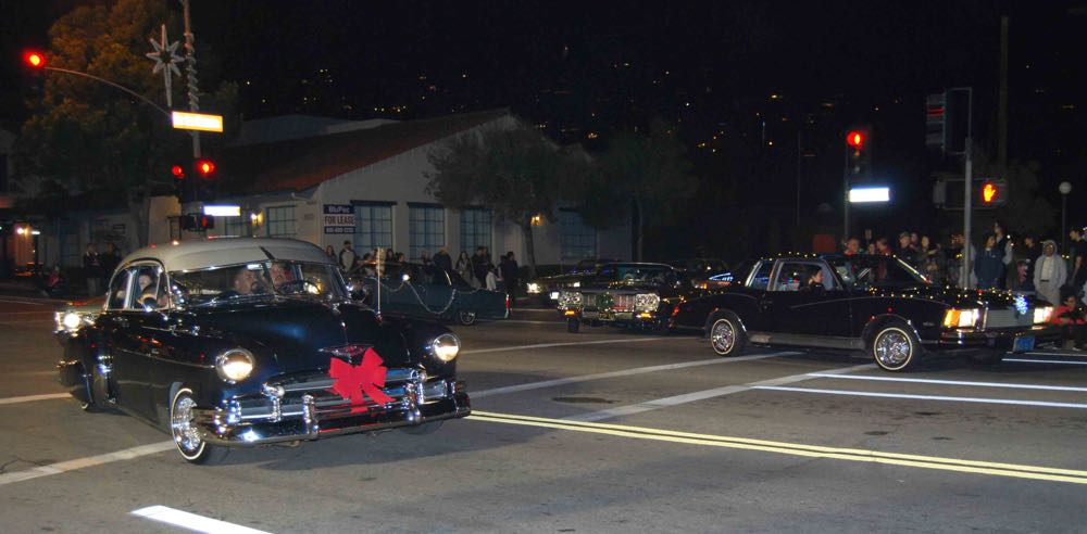 Locals driving vintage and classic cars participated Saturday night in the annual Milpas Holiday Parade.