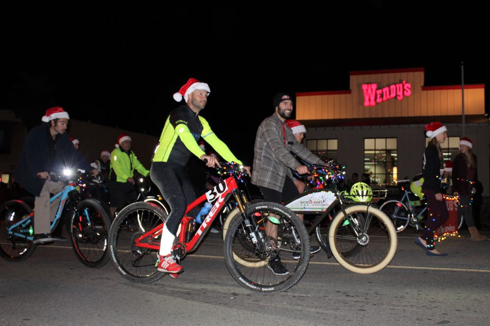 The merry cyclists of Bicycle Bob's roll along Hollister Avenue during Old Town Goleta's inaugural Christmas parade.