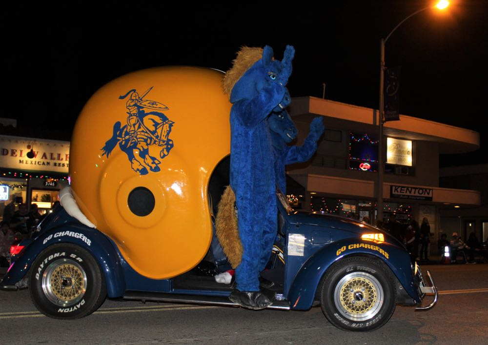Dos Pueblos High School mascots charged along Hollister Avenue Saturday evening in their football helmet buggie.
