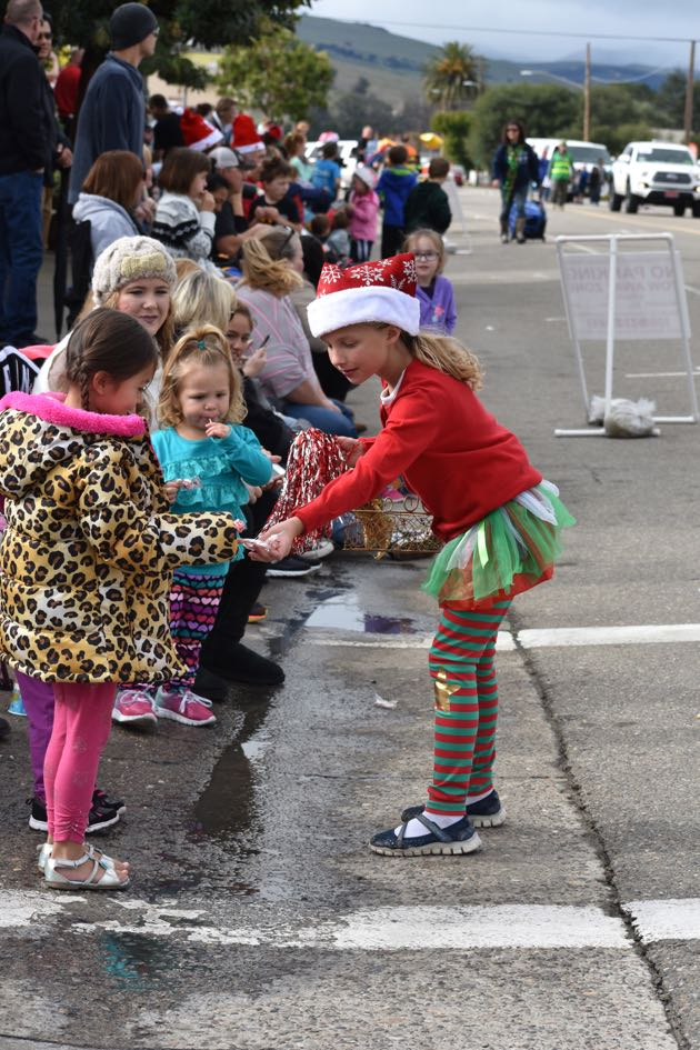 Children along the parade route collected candy canes and other sweets.
