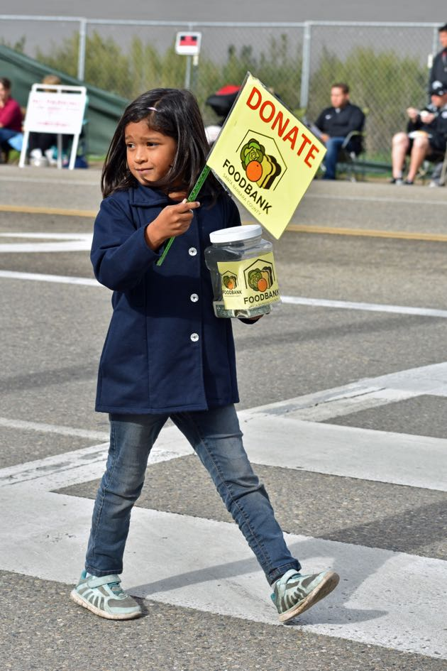 A young volunteer was on hand to accept donations for the Foodbank of Santa Barbara County.