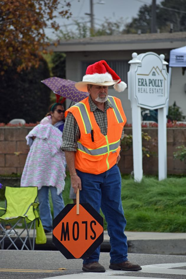 An Old Town Orcutt Christmas Parade worker dons a Santa cap on top of his cowboy hat.