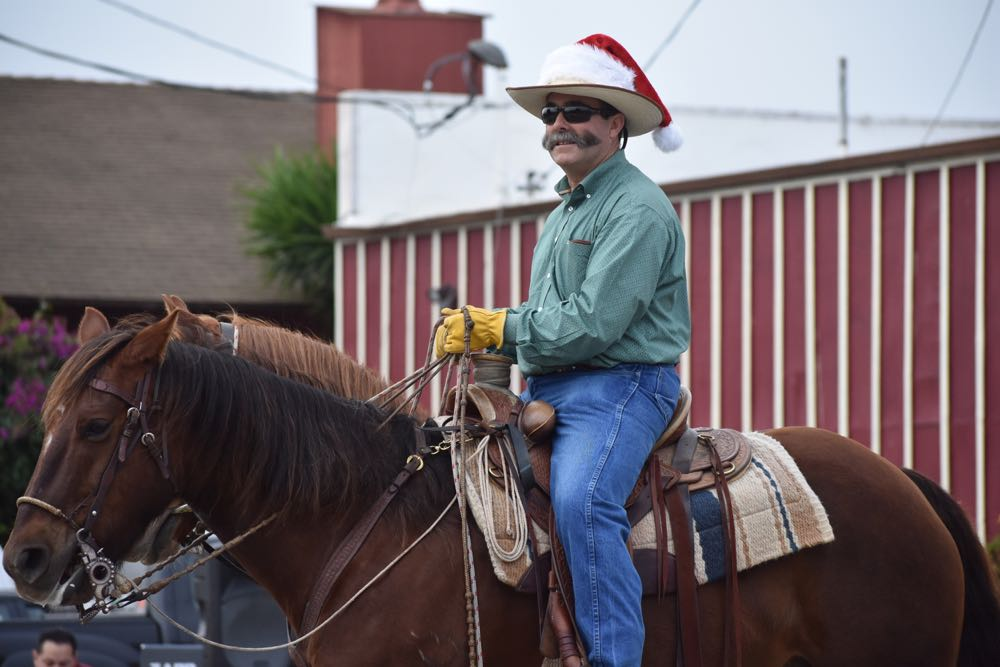 Santa Barbara County Fourth District Supervisor Peter Adam rides his quarterhorse in the Old Town Orcutt Christmas Parade.