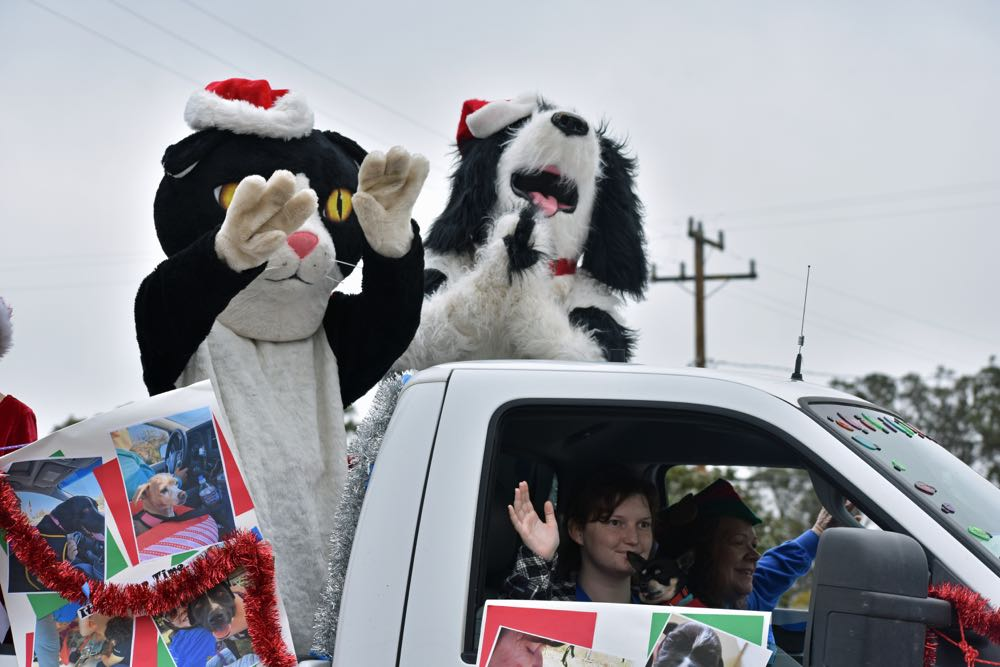 The mascots of Santa Barbara County Animal Services pitch the adoption option, instead of shopping for pets.The pickup was adorned with pictures of available shelter animals.