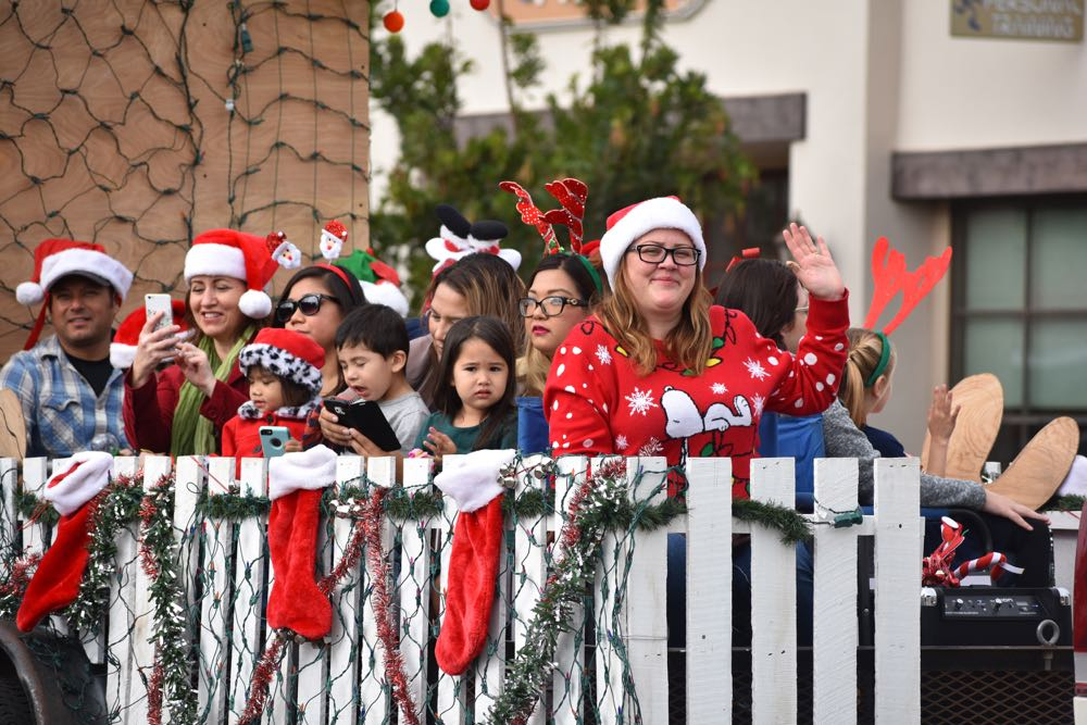 Community Bank of Santa Maria employees and families members ride in a float during the Old Town Orcutt Christmas Parade.