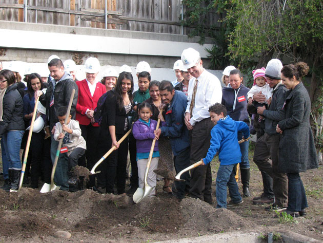 <p>Families selected to receive single-family homes in Habitat for Humanity&#8217;s Canon Perdido Street project, including the Pachecos at center, lend helping hands at Wednesday&#8217;s groundbreaking ceremony.</p>