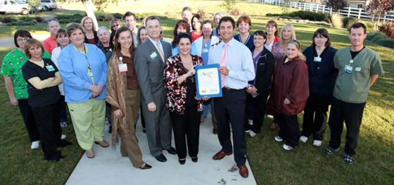 Assemblyman Das Williams presents an official California Assembly proclamation on Tuesday to staff and executives at Santa Ynez Valley Cottage Hospital. (Santa Ynez Valley Cottage Hospital photo)