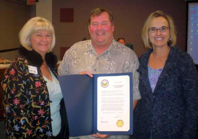 Carpinteria Valley Chamber of Commerce CEO Lynda Lang, left, Carpinteria Mayor Brad Stein and Community Awards Banquet chair Karen Graf with the proclamation declaring January 2013 as Business Month in Carpinteria. (Carpinteria Valley Chamber of Commerce photo)