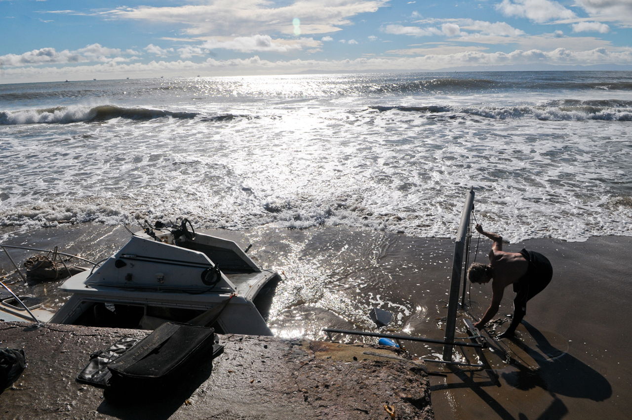 A small boat washes up on Fool's Anchorage at East Beach on Friday.