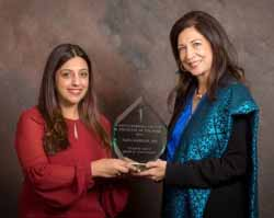 Dr. Priti Gagneja, left, presents the award for 2017 Physician of the Year for Santa Barbara County to Dr. Saida Hamdani.