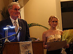 Emcee Larry Crandell basks in adulation with 2007 Goleta Teen of the Year Valerie Mehlschau.