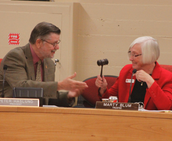 Dr. Peter Haslund passes on the gavel to newly appointed board president Marty Blum. (Gabriella Slabiak / Noozhawk photo)