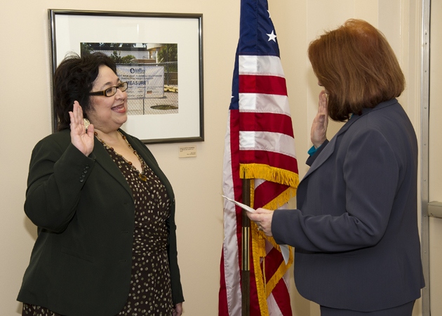 Hilda Zacarias, left, the newest member of the Allan Hancock College Board of Trustees, is sworn in by Interim Superintendent/President Elizabeth Miller. (Allan Hancock College photo)