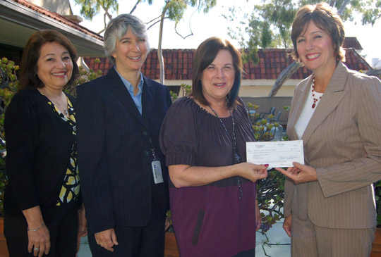 <p>Joined by Irene Macias, left, and Beverly Schwartzberg of the Santa Barbara Public Library, Michele Allyn, president of the Friends of the Santa Barbara Public Library, accepts a check for a $9,700 literacy grant from Holly Cole of Verizon Communications.</p>