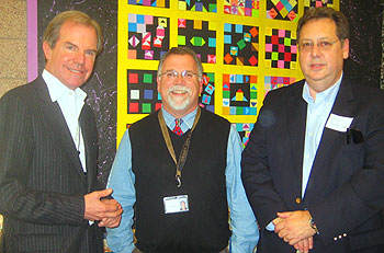 From left, One Laptop Per Child founder Nicholas Negroponte, Kellogg School teacher D.J. Perry and Bill Grant of UCSB during a classroom photo op.