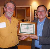 Mario Borgatello of MarBorg, right, accepts an award for allowing the Sierra Club to collect used cell phones and toner cartridges at its facility for recycling and for fundraising