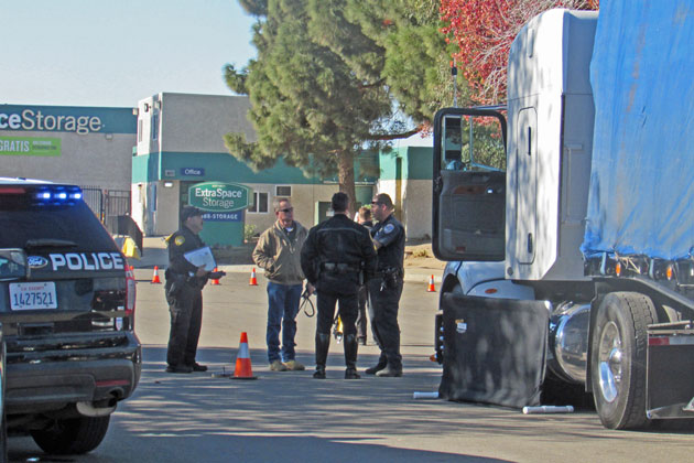 A partition shields the body of a pedestrian who was struck by a semi and killed Tuesday on West Cook Street in Santa Maria.