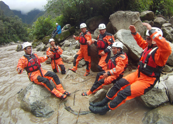 Members of Santa Barbara County Search & Rescue teach swiftwater rescue techniques to members of Machu Picchu SAR in Peru, training in the Urubamba River's rapids. (Santa Barbara County Search & Rescue photo)