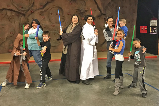 Princess Leia and the Jedi knight pose with youths and adults who attended the Santa Maria Valley Discovery Museum's lightsaber skills demonstration class on Thursday.