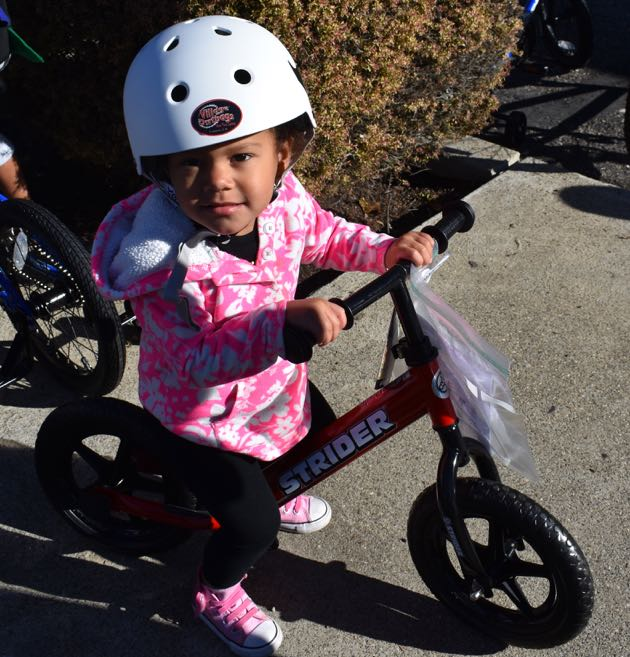 Vivienne Rockwoid, 2, was among more than 100 children of military members at Vandenberg Air Force Base to receive bikes through the Village Dirtbags program.
