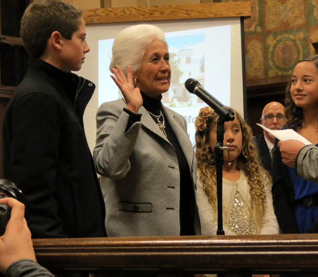 With her grandchildren at her side, Santa Maria Mayor Alice Patino takes her oath of office Tuesday night. She is the first woman in the city's history to hold the position. (Gina Potthoff / Noozhawk photo)