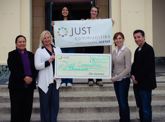 Cecilia Tavera, left, and Patricia Bartoli-Wible, second from left, of Southern California Edison present a $5,000 check to Elizabeth Weinstein and Jarrod Schwartz of Just Communities. Santa Barbara High School senior Ivette Gil, back left, and junior Olivia Ranson are participants in Just Communities and the Community Leadership Institute. (Just Communities photo)