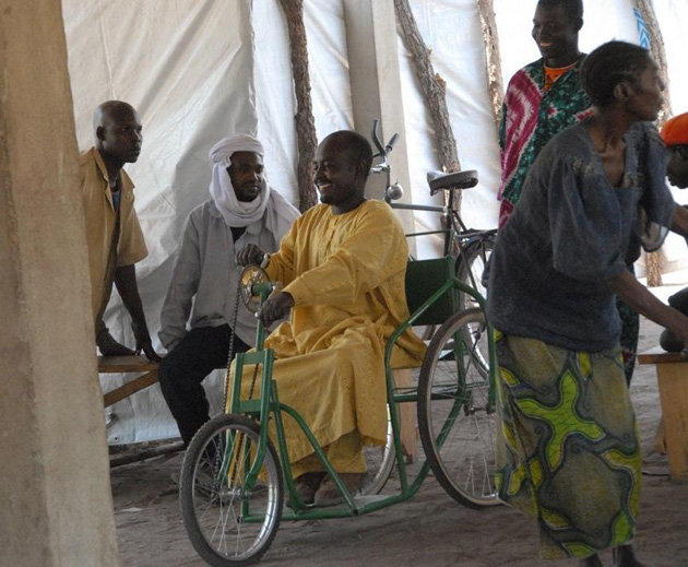 With a wheelchair tricycle, a disabled refugee in south Chad has newfound mobility. (William Felstiner / UCSB photo)