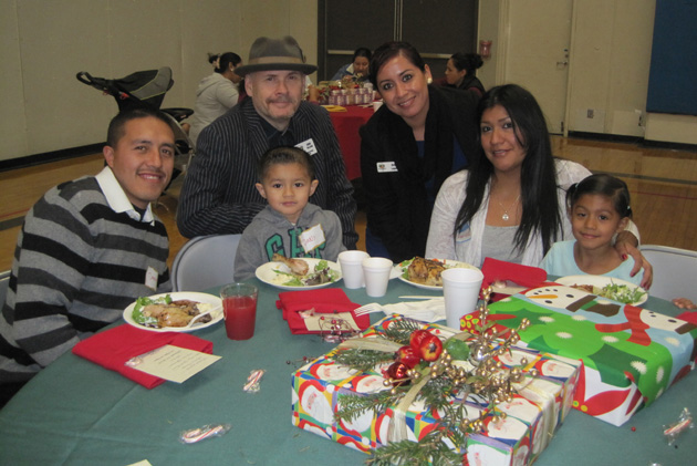 Foodbank of Santa Barbara County CEO Erik Talkin, back left, and outreach manager Amy Lopez thank the Maricruz family — Daniel, Daniel Jr., Maricruz and Aileen — during the Holiday Volunteer Appreciation Luncheon held at the Page Youth Center. (Foodbank of Santa Barbara County photo)