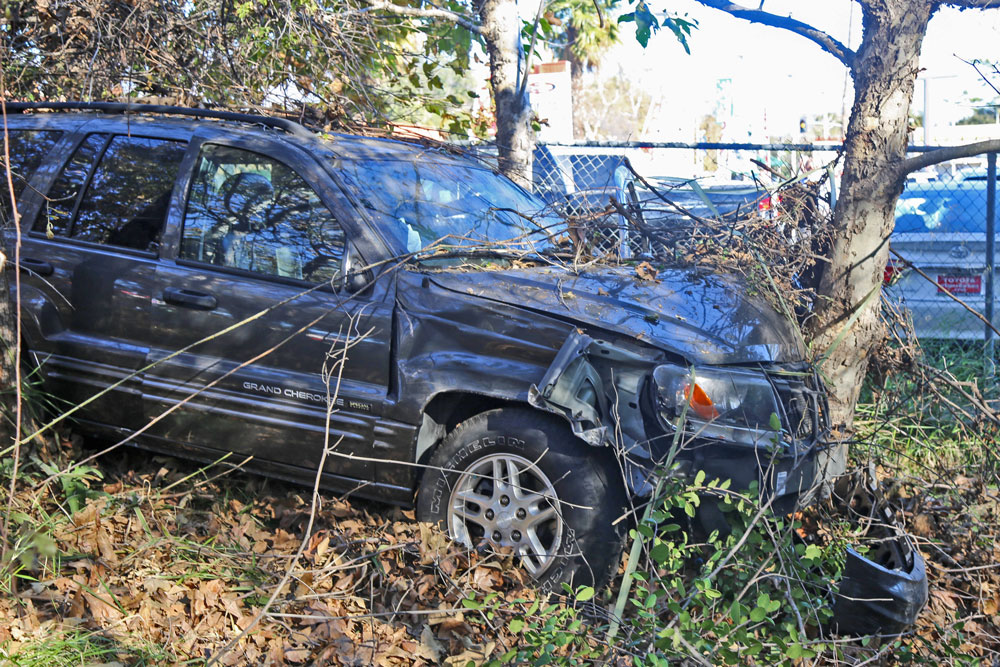 A woman sustained minor injuries Tuesday when an SUV ran off the roadway on Hollister Avenue in Goleta and crashed into a tree.