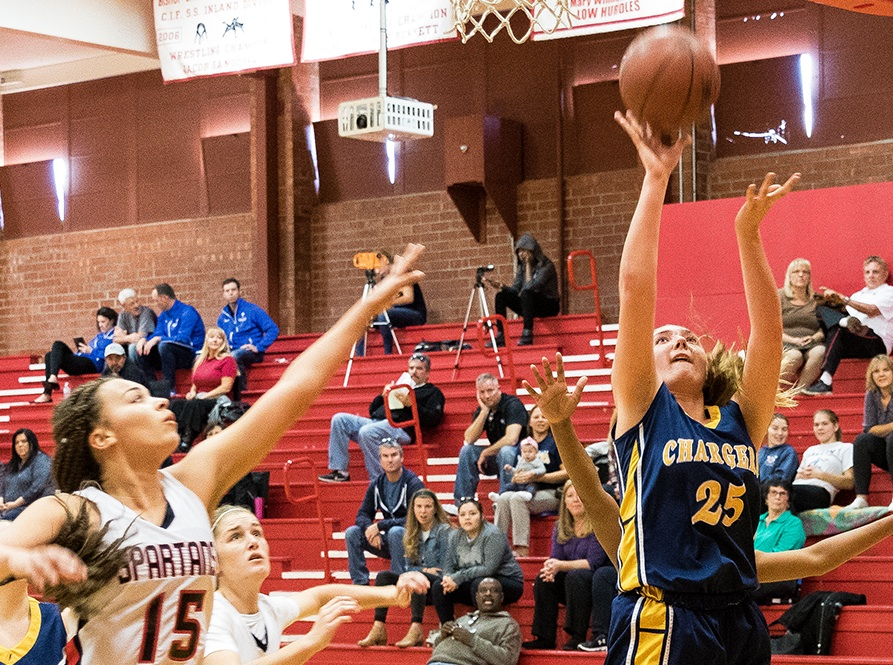 Amber Belletti of Dos Pueblos drives to the hoop against Rio Mesa's Catalina Escobal. Belletti scored 10 points.