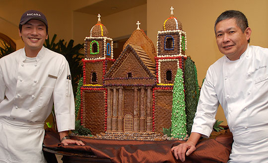 Bacara Resort & Spa pastry cook Zi Nguyen, left, and executive pastry chef Ben Galang pose with their gingerbread mission masterpiece.