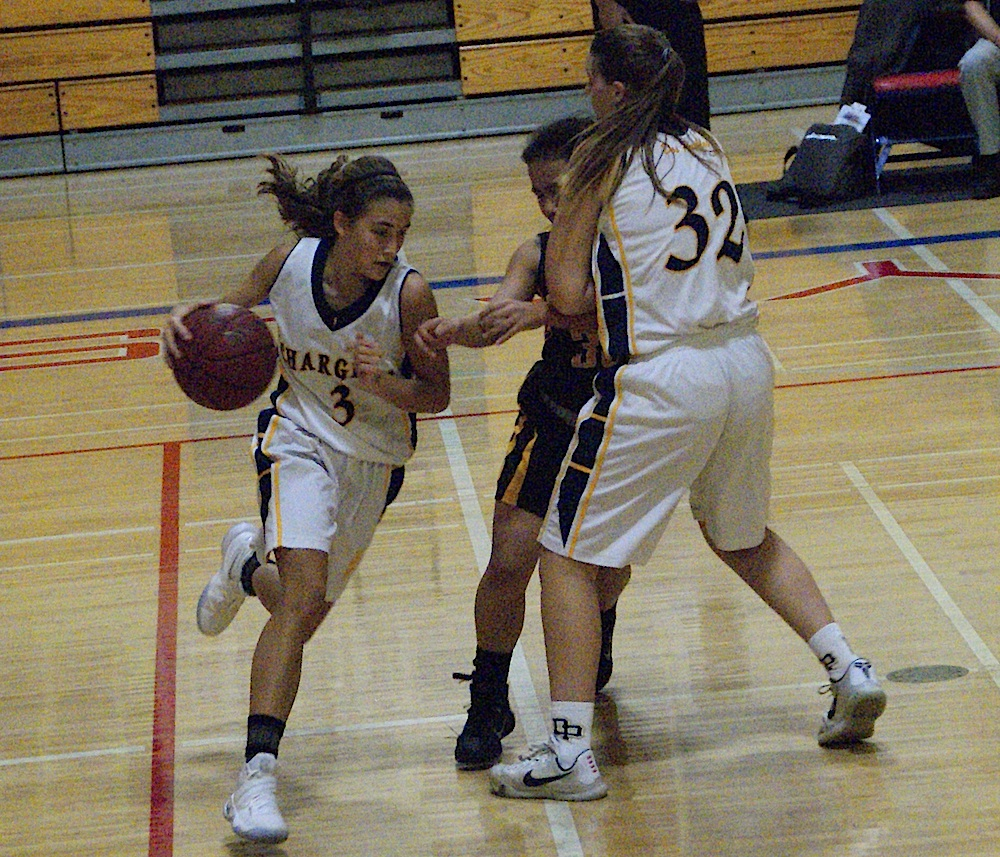 Lauren Noggle sets a pick for Dos Pueblos teammate Camila Casanueva during the Chargers' win over El Dorado.