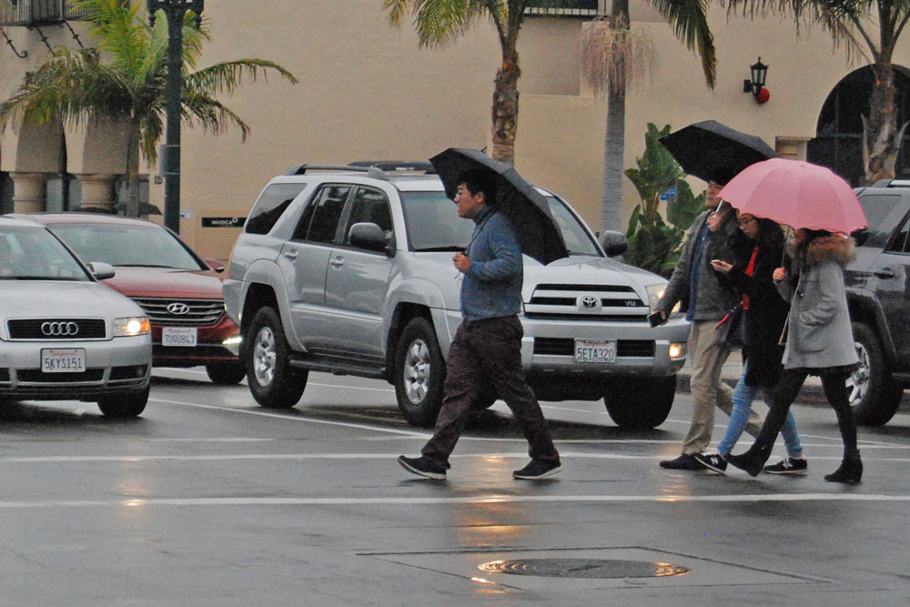 Umbrellas were out in force in downtown Santa Barbara on Friday, as a fast-moving storm soaked the region, dropping more than 2 inches of rain in some locations.
