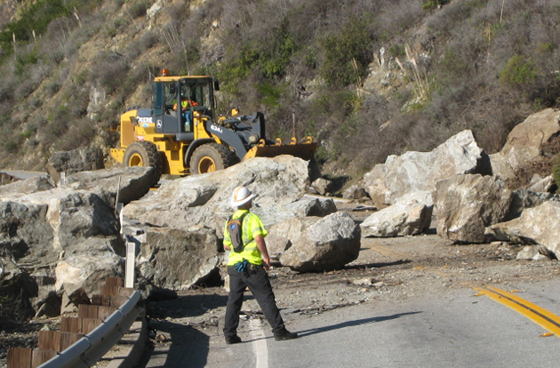 Crews work to clear a rock slide on Highway 1 at Partington Ridge Road. (Caltrans photo)