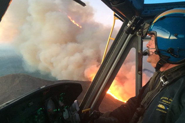 A view of the Solimar Fire from the cockpit of Ventura County Sheriff's Department Aviation Unit Copter 7, which made water drops through the night on the blaze.