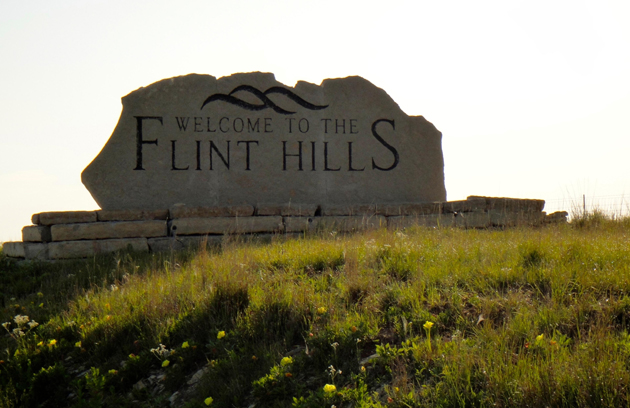 A welcome sign greets visitors to Flint Hills in Kansas.