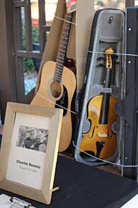 Country music legend Charlie Daniels sent an autographed fiddle for the Rebuild the Ranch silent auction.