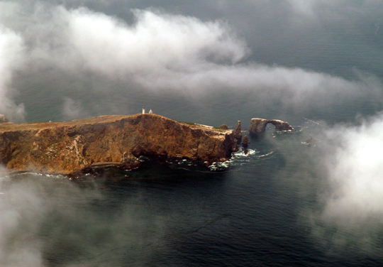 Fog clouds Anacapa Island. Weather must always be considered and monitored when going to sea on multiple-day fishing trips.