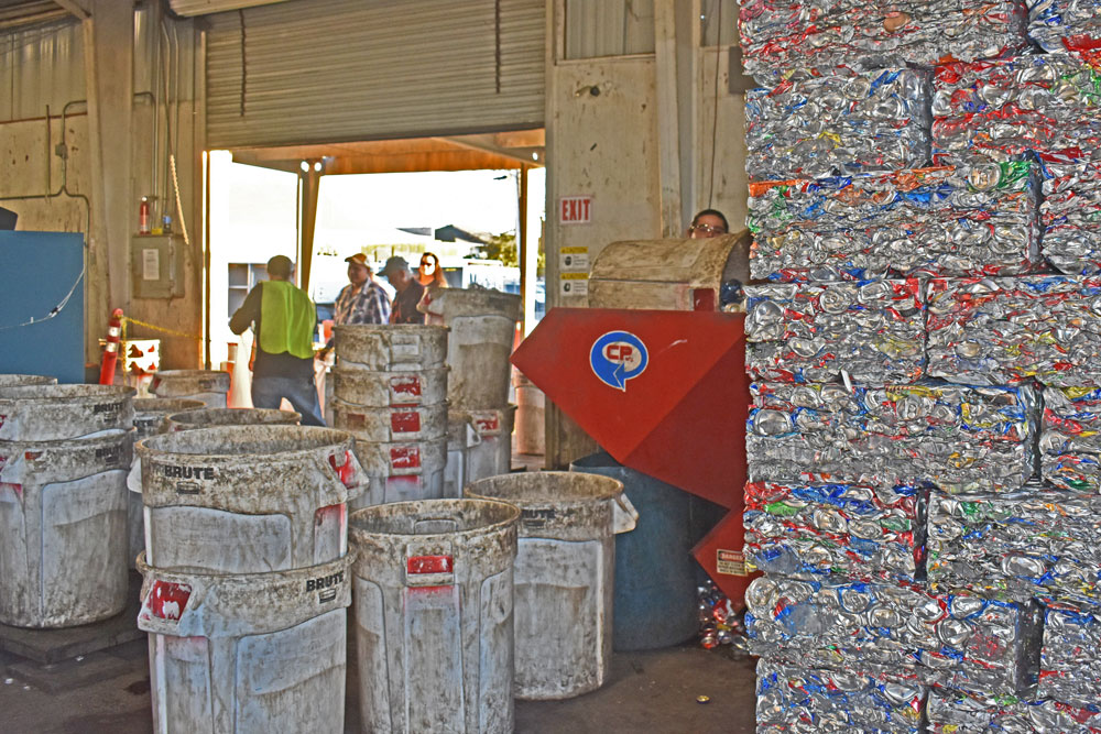 Bales of recyclables are stacked on a pallet as Larrabee Recycling customers bring more items before the Santa Maria facility closes on Friday.