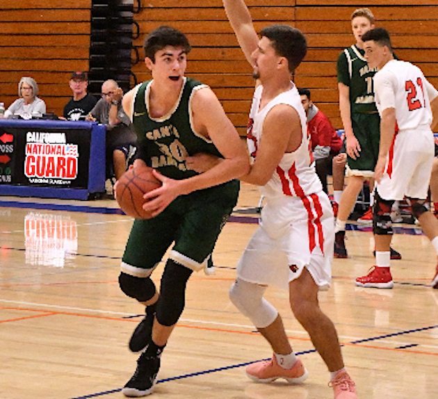 Bryce Warrecker of Santa Barbara tries to drive around Bishop Diego's Dylan Streett. Warrecker scored 22 points in the Dons' 56-51 win.