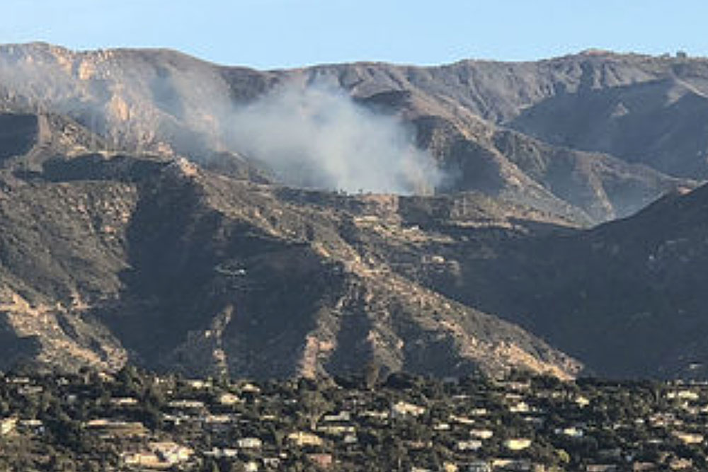 Smoke rises from a flare-up of the Thomas Fire off Gibraltar Road in the hills above Santa Barbara Friday morning. Officials say the flames are well within containment lines and not a threat to spread.