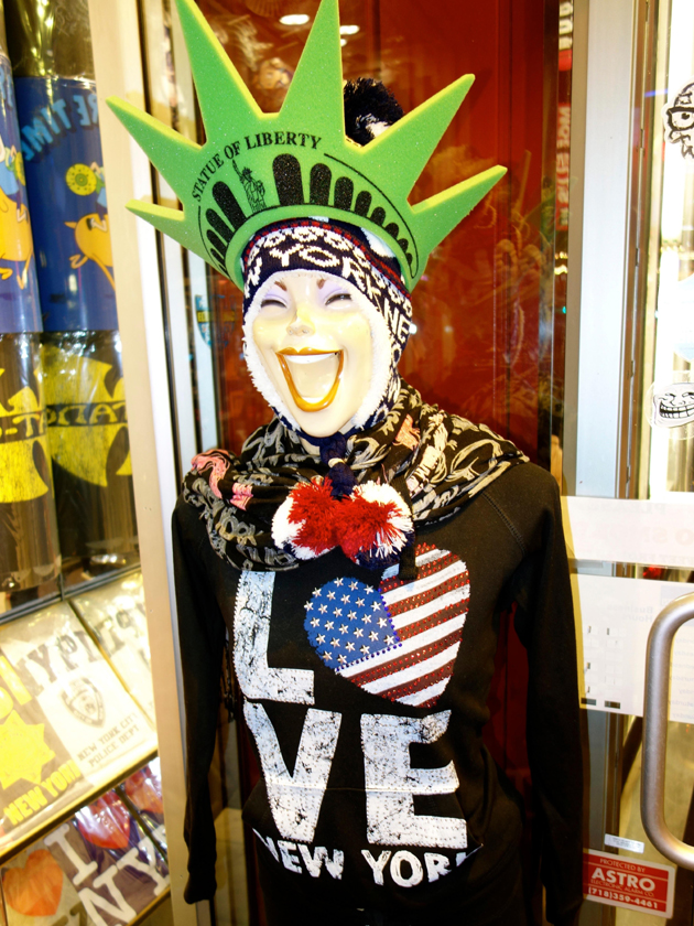 A statue of liberty in Times Square.